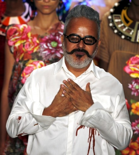 Brazilian designer Ronaldo Fraga appears at the end of the presentation of his collection during Sao Paulo Fashion Week show in Sao Paulo