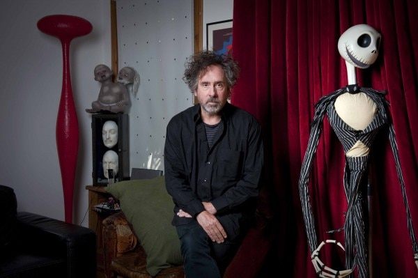 Tim Burton at his studio, beside Jack Skellington, a character from