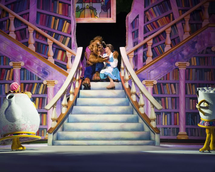 D33_Belle and Beast on stairs_Copyright Feld Entertainment