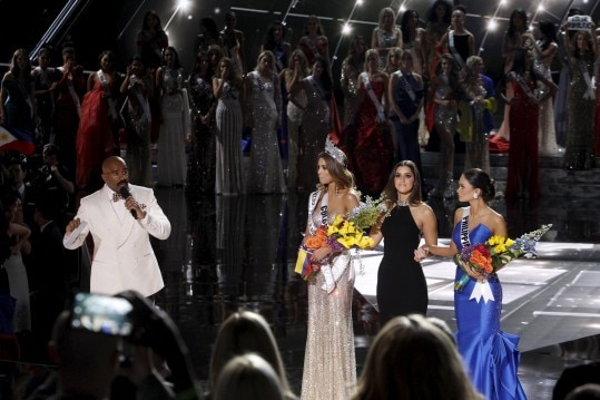 Host Steve Harvey (far L) speaks as Miss Colombia Ariadna Gutierrez (L), Miss Universe 2014 Paulina Vega (C) and Miss Philippines Pia Alonzo Wurtzbach listen onstage during the 2015 Miss Universe Pageant in Las Vegas, Nevada, December 20, 2015. Miss Colombia was originally announced as the winner but Harvey said he made a mistake when reading the card. Miss Philippines Pia Alonzo Wurtzbach is the actual winner. REUTERS/Steve Marcus ATTENTION EDITORS - FOR EDITORIAL USE ONLY. NOT FOR SALE FOR MARKETING OR ADVERTISING CAMPAIGNS TPX IMAGES OF THE DAY