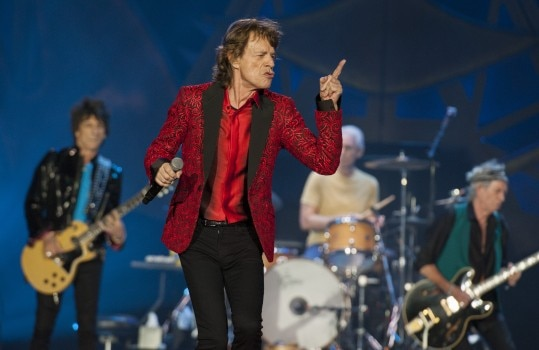 FILE - In this July 4, 2015 file photo, Ronnie Wood, Mick Jagger, Charlie Watts and Keith Richards of the Rolling Stones perform at the Indianapolis Motor Speedway in Indianapolis. On Thursday, Nov. 5, 2015, the band announced ?The America Latina Olé? tour, which will kick off Feb. 3 in Santiago, Chile. (Photo by Barry Brecheisen/Invision/AP)