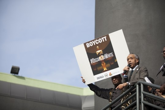 The Rev. Al Sharpton speaks to protesters of the Academy Awards at Sunset Boulevard and Highland Avenue in Los Angeles, Feb. 28, 2016. Sharpton earlier attacked the movie industry for what he described as repeated broken promises on diversity. (Jenna Schoenefeld/The New York Times)