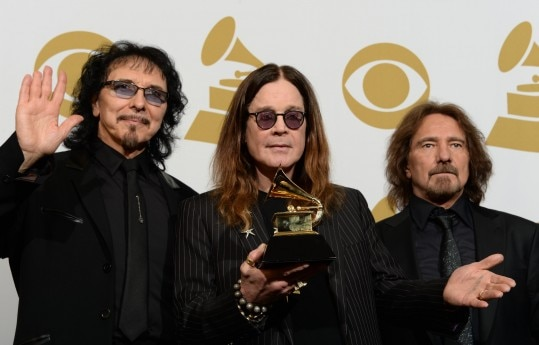 (FILES) In this January 26, 2014 file photo, Tony Iommi (L), Ozzy Osbourne (C) and Geezer Butler (R) of Black Sabbath pose in the press room after winning Best Metal Performance for 'God is Dead?' during the 56th Grammy Awards at the Staples Center in Los Angeles, California. Heavy metal pioneers Black Sabbath on October 27, 2015 announced a slew of new concerts as the band extended a 2016 tour that it insists will be its last. Ozzy Osbourne's band, previously scheduled to call it quits in April in New Zealand, will play across Europe and North America throughout the summer. The final concert is now scheduled to take place on September 21 in Phoenix, Arizona. The tour -- dubbed