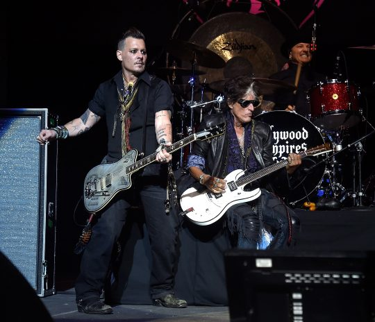 BROOKLYN, NY - JULY 10: Johnny Depp and Joe Perry of Hollywood Vampires perform at Ford Ampitheater at Coney Island Boardwalk on July 10, 2016 in Brooklyn, New York. Kevin Mazur/Getty Images /AFP