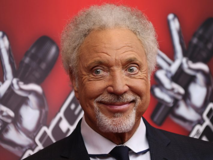 British singer Sir Tom Jones smiles as he arrives for a photo call for The Voice UK at the BBC Broadcasting House in central London, Monday, Jan. 6, 2014. (Photo by Joel Ryan/Invision/AP)