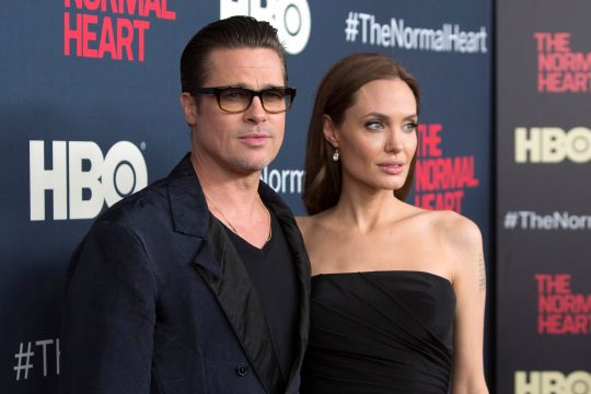 Actors Brad Pitt and Angelina Jolie attend the premiere of
