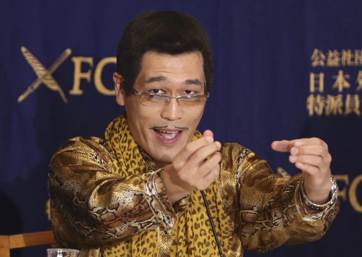 "Japanese comedian Pikotaro speaks during a press conference in Tokyo, Friday, Oct. 28, 2016. Pikotaro behind the viral hit ""PPAP"" said he is astonished by the global success of his ""pen-pinapple-apple-pen"" song. (AP Photo/Eugene Hoshiko)"