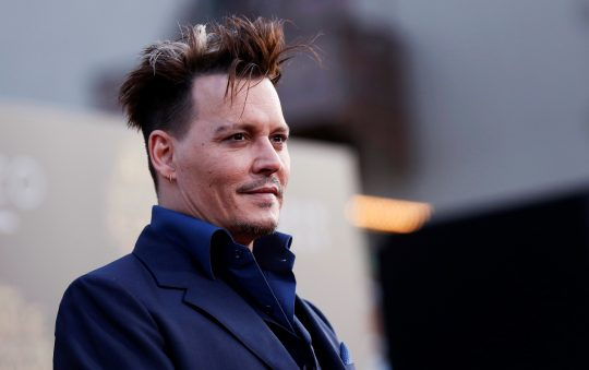 Cast member Johnny Depp poses at the premiere of