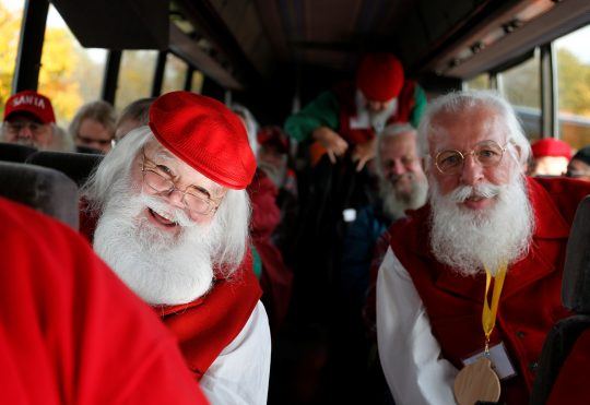 Santas board a bus for a field trip from the Charles W. Howard Santa Claus School in Midland, Michigan, U.S. October 28, 2016. REUTERS/Christinne Muschi SEARCH