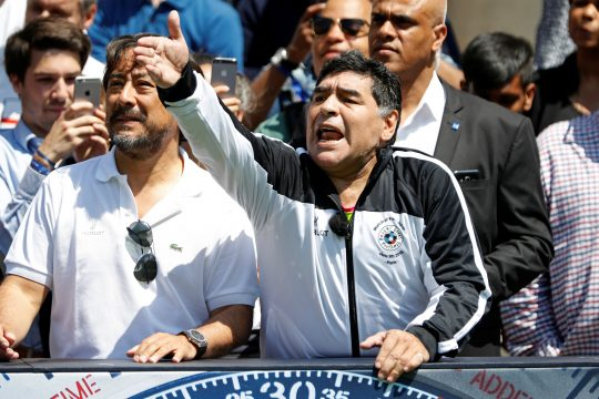 Football legend Diego Maradona reacts during an advertising event on the eve of the opening of the UEFA 2016 European Championship in Paris, France, June 9, 2016 . REUTERS/Charles Platiau