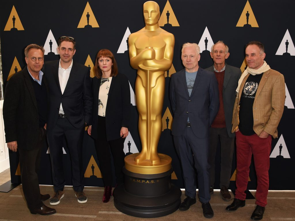 (L-R) Mark Johnson, Academy Governor, directors nominated for best Foreign langauge Film Martin Zandvliet, Maren Ade, Hannes Holm, Martin Butler and Bentley Dean arrive for the 89th Academy Awards Foreign Language Film reception in Beverly Hills, California on February 25, 2017. / AFP PHOTO / ANDREW CABALLERO-REYNOLDS