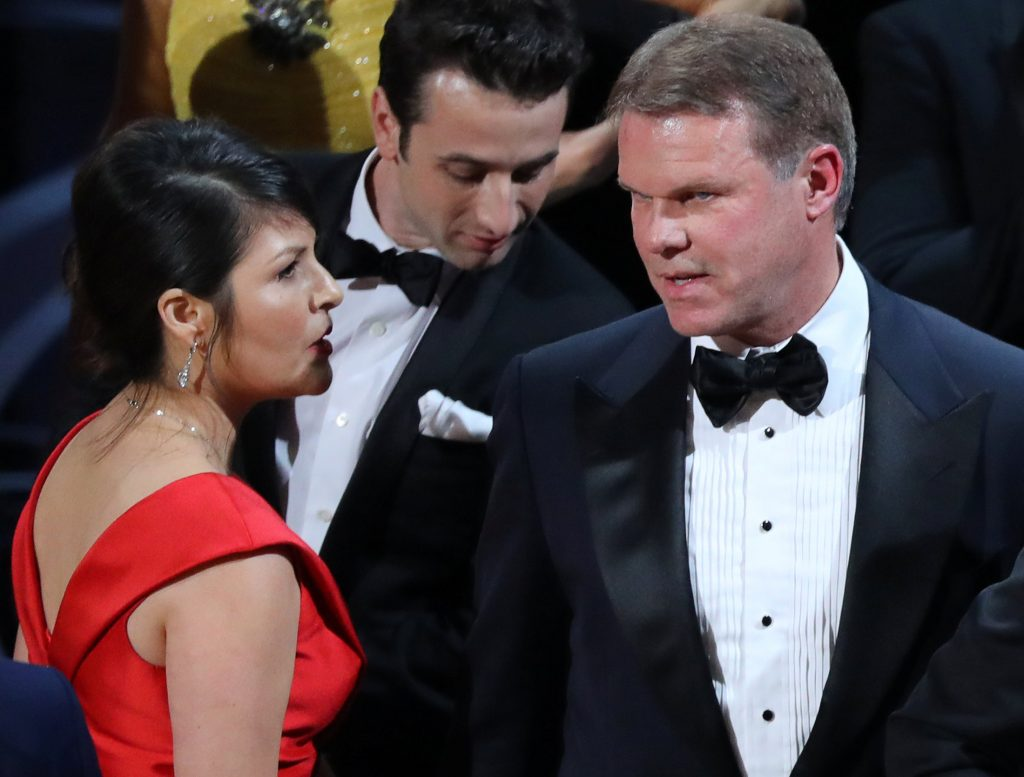 89th Academy Awards - Oscars Awards Show - Hollywood, California, U.S. - 26/02/17 - Martha Ruiz (L) and Brian Cullinan (R) of PricewaterhouseCoopers confer on stage after the Best Picture was mistakenly awarded to