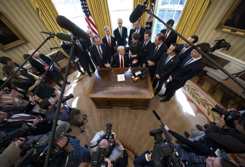 FILE -- President Donald Trump signs an executive order in the Oval Office of the White House in Washington, Feb. 24, 2017. Trump has stumbled into the most conventional of Washington traps: believing he can master an entrenched political press corps with far deeper connections to the permanent government of federal law enforcement and executive department officials than he has. (Doug Mills/The New York Times)