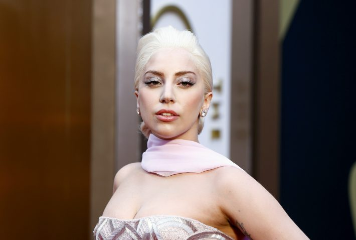 Lady Gaga arrives at the 86th Academy Awards in Hollywood, California March 2, 2014. REUTERS/Lucas Jackson (UNITED STATES TAGS: ENTERTAINMENT) (OSCARS-ARRIVALS)