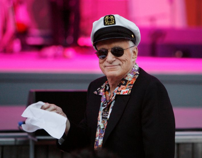 FILE PHOTO - Hugh Hefner, founder of Playboy magazine, twirls a napkin during a performance by Dr. John and the Lower 911 at the 30th annual Playboy Jazz Festival at the Hollywood Bowl in Hollywood, California June 14, 2008. REUTERS/Fred Prouser/File Photo