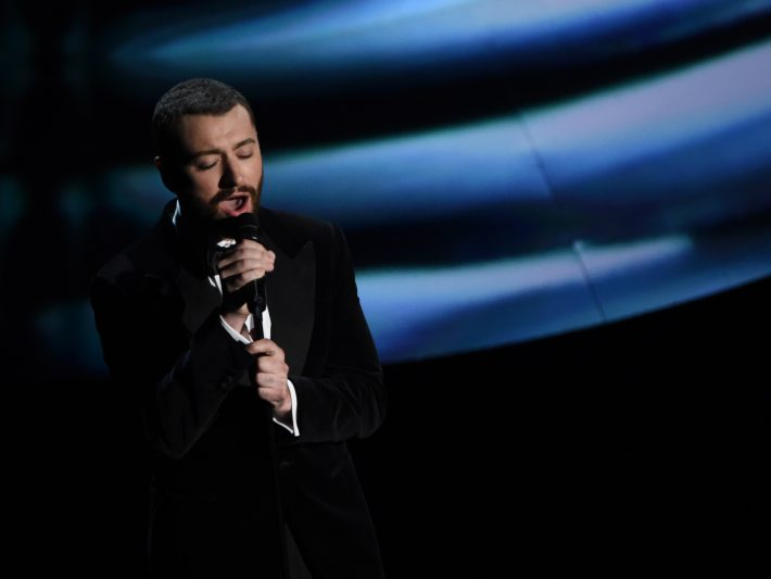 (FILES) This file photo taken on February 28, 2016 shows singer Sam Smith performing on stage at the 88th Oscars in Hollywood, California. Sam Smith, the English soul singer whose debut album three years ago quickly propelled him to stardom, is back with new music -- and heartache apparently is still on his mind. Smith said that a new song,