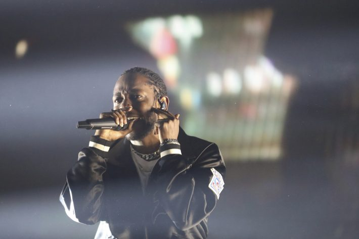 """FILE-- Kendrick Lamar performs on the opening night of his tour for his album """"DAMN."""" at Gila River Arena in Phoenix, Ariz., July 12, 2017. Kendrick Lamar's """"DAMN."""" has earned seven nominations for the 60th annual Grammy Awards, including album of the year and record of the year. (Caitlin O'Hara/The New York Times)"""