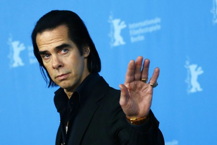 Cast member Nick Cave poses during a photocall promoting the movie