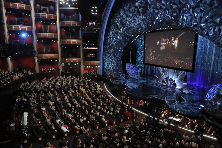 90th Academy Awards - Oscars Show - Hollywood, California, U.S., 04/03/2018 - Host Jimmy Kimmel and actors are shown on the big screen as they deliver candy to people in a movie theatre next door to the Dolby Theatre. REUTERS/Lucas Jackson