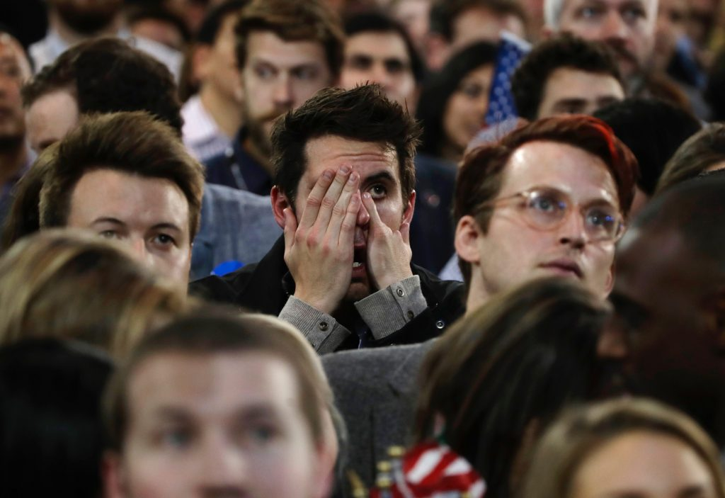 Supporters react to election results during Democratic presidential nominee Hillary Clinton's election night rally in the Jacob Javits Center glass enclosed lobby in New York, Tuesday, Nov. 8, 2016. (AP Photo/Frank Franklin II)